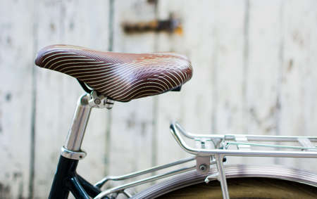 Vintage bicycle with leather seat close up