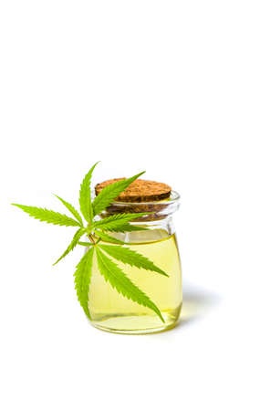 Cannabis oil bottle and marijuana leaf isolated