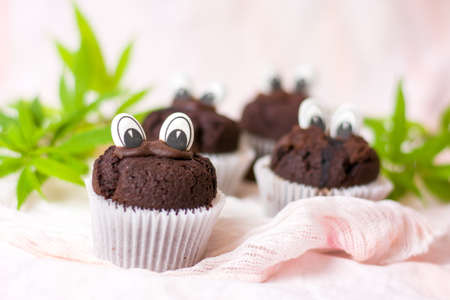 Chocolate muffins with marijuana and edible eyes in paper holders