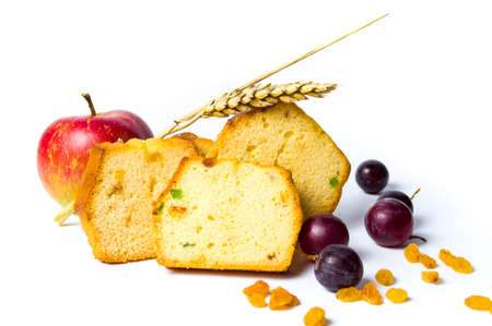 Homemade fruit bread with raisins, grape and apple on white