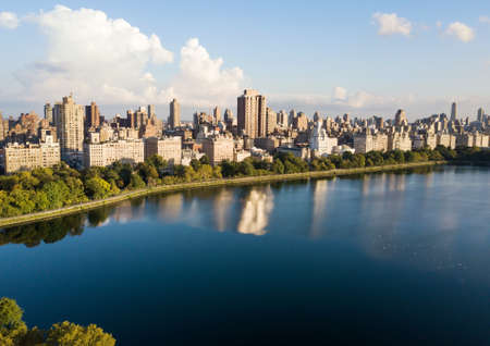 Central park reservoir with New York cityscape aerial view