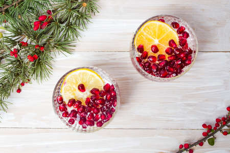 Pomegranate juice with fruit seeds top view