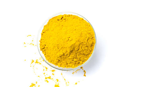 Curry powder in a bowl isolated on white