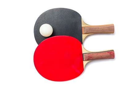 Two table tennis rackets and a ball isolated on white
