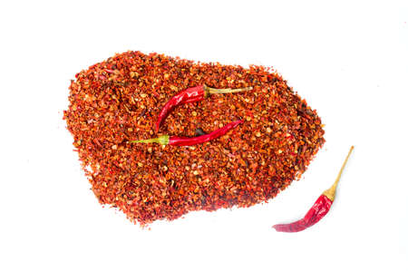 Smashed red pepper powder on a pile isolated on white Stock Photo