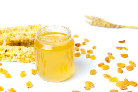 Honey jar with corn fruit dessert bars isolated Stock Photo
