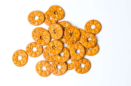 Round salty pretzels isolated on white background Stock Photo