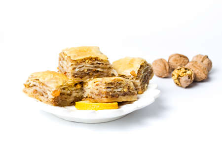 Baklava dessert slices on a plate isolated