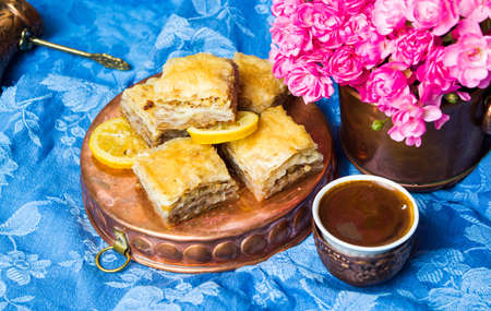 Baklava dessert with Turkish coffee in copper cups