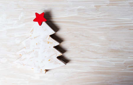 Christmas tree miniature on a wooden background with copy space