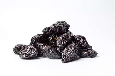 Dried plum fruits on white background isolated