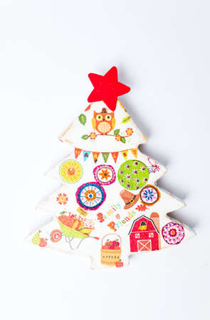 Decoupage Christmas tree decoration on white background Stock Photo