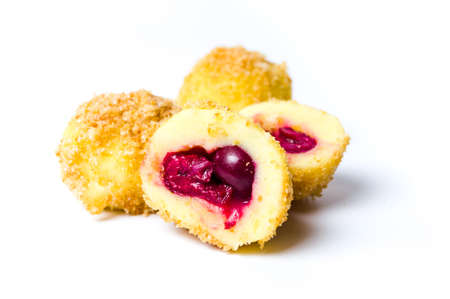 Homemade bread crumb dumplings with cherry fruit isolated