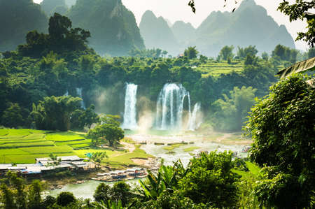 Ban Gioc Detian Falls with unique natural beauty on the border between China and Vietnam Фото со стока