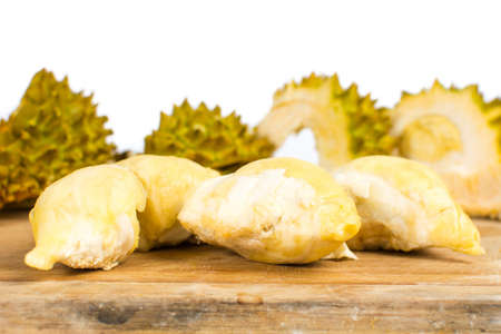Peeled durian  fruit with peel on a wooden board Stock Photo