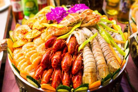 Various seafood arranged on the food market street