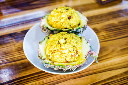 Pineapple fry rice served on natural pineapple shell Stock Photo