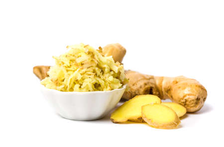 Chopped and shredded Ginger root isolated on white background