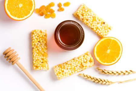 Jar of honey and orange, honey dessert isolated on white background