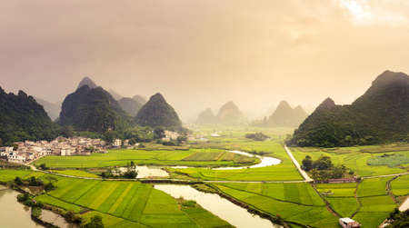 Stunning rice fields and karst formations scenery in Guangxi province of China