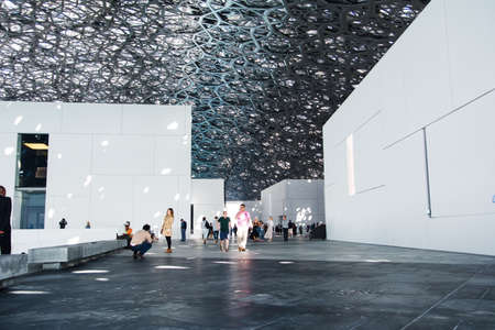 ABU DHABI, UNITED ARAB EMIRATES - JANUARY 26, 2018: Louvre Abu Dhabi modern hall with Rain of Light roof design