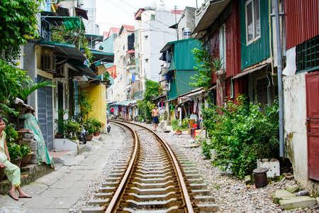 HANOI, VIETNAM - MAY 23, 2017: Hanoi train street with railroad passing through the neighborhood representing bad living conditions. Vietnam travel Sajtókép