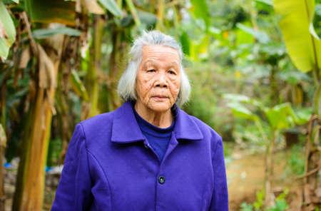 Portrait of senior asian grandma walking outdoors