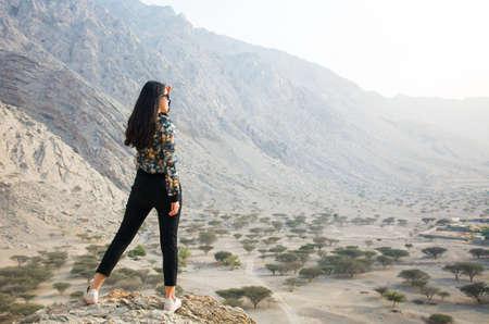Girl enjoying scenery on a desert hiking trip