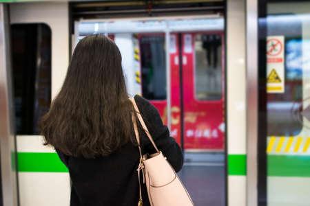 Girl entering metro at a subway station