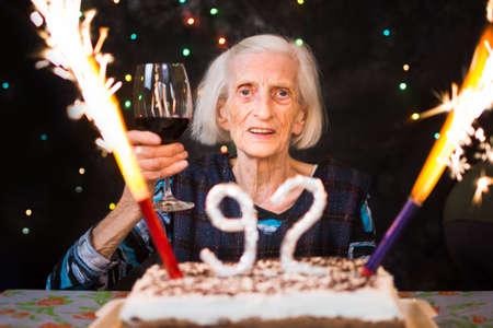Senior woman toasting on her birthday celebration party