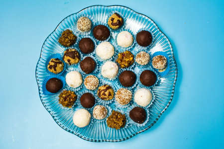 Homemade cookies in paper cups on blue background top view
