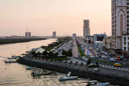 Ras Al Khaimah, United Arab Emirates - March 3, 2018: Ras Al Khaimah Corniche road and creek at dusk, the heart of northern emirate of the UAE Редакционное