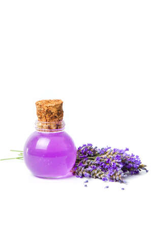 Lavender oil and flower bouquet isolated on white Stock Photo