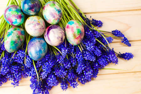 Hand painted Easter eggs and purple spring flowers