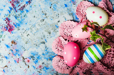 Colorful Ester eggs on hand painted blue background Stock Photo