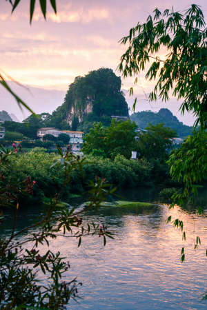 Sunset scene in Guilin, China, with stunning rock and river