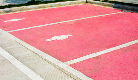 Bigger parking lot painted in pink for female in China Stock Photo