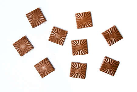 Chocolate pieces isolated on white background, cacao dessert