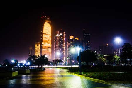 Abu Dhabi modern cityscape view from Corniche at night