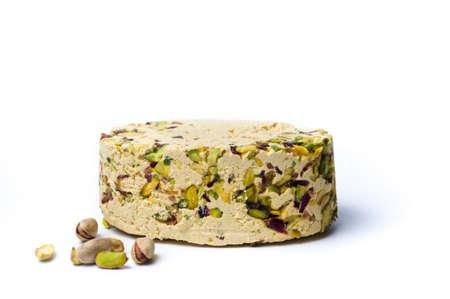 Halva with pistachio isolated on white background