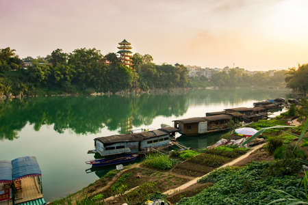 Amazing sunset over a lake in Guangxi province of China Stock Photo
