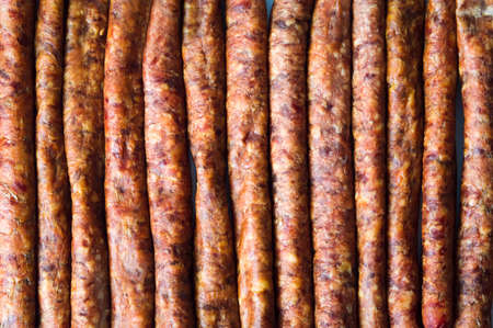 Homemade sausages in a row background pattern Stock Photo