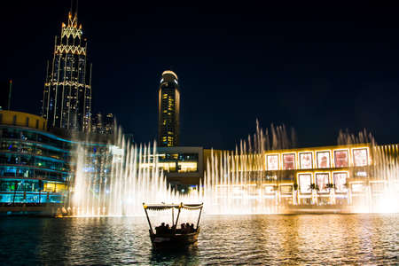 Dubai, United Arab Emirates - February 5, 2018: Dubai fountain show at night which attracts many tourist every day. The Dubai Fountain is the world's largest choreographed fountain system set on the 30-acre man made Burj Khalifa Lake