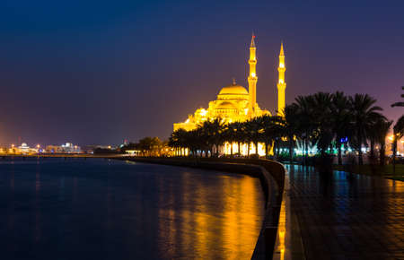 Al Noor mosque in Sharjah reflected in the lake at night Stock Photo