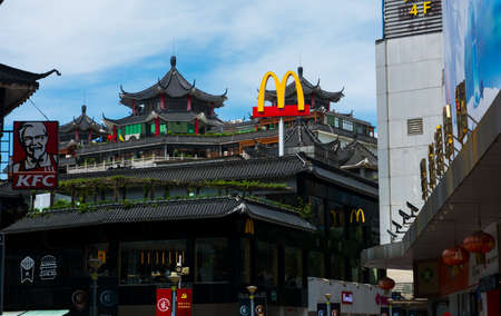 Shenzhen, China - July 16, 2018: McDonalds and KFC in China, Dong Men Pedestrian street in the old Shenzhen in traditional shaped building