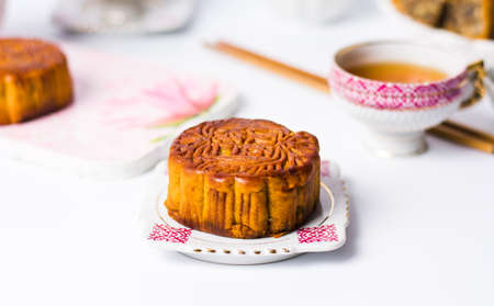 Traditional Chinese Mooncake with tea isolated on white background Stock Photo