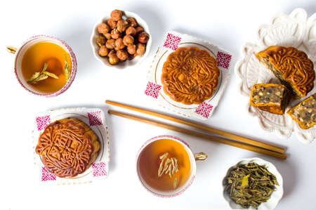 Chinese Mooncake served with cup of tea top view