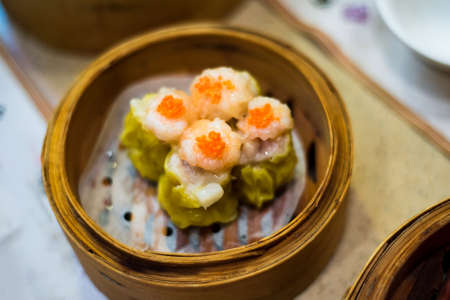 Chinese Cantonese dimsum meal served in traditional bamboo steamer