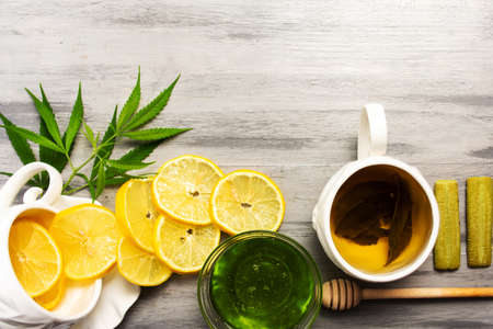 Cannabis green honey with lemon tabletop view