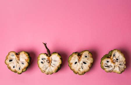 Custard apple fruit on a pink background